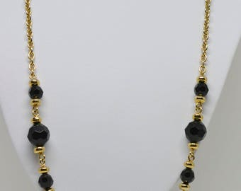 Gold tone and black beads necklace