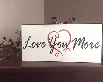 Love you more, Valentine sign