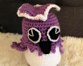 A hand crochet owl wearing purple clothing Children welcome