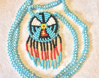 Vintage hand made tribal Native American Thunderbird necklace .