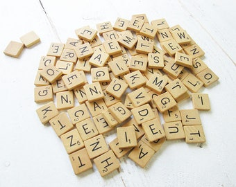 Vintage wooden scrabble tiles or game pieces, set of 100.