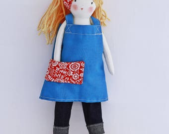 Handmade rag doll, Flora wears a knit cardigan woolen jeans hat and an apron