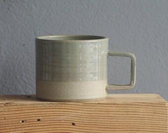 mug. ready made low handle mug. ice blue glaze on sand colored clay. modern mug. handmade pottery.