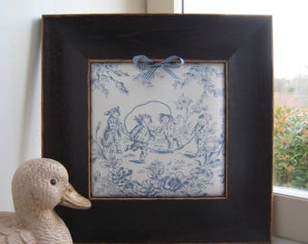 French toile de jouy ecru and blue frame scene of children's games