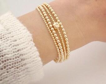 single cube beaded bracelet in gold