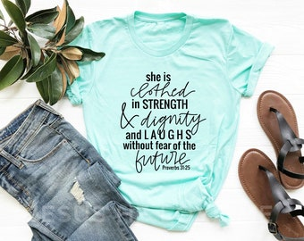 Christian T-shirts She is clothed in strength & dignity and laughs without fear of the future proverbs 31:25 pastel unisex tee