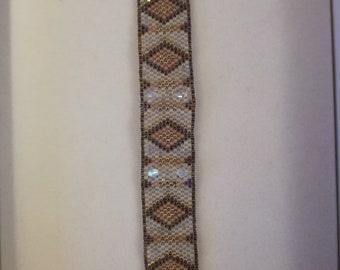Handmade hand-sewn bracelet with glass beads and Swarovski