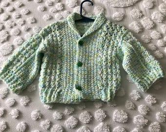 Hand crocheted baby sweater
