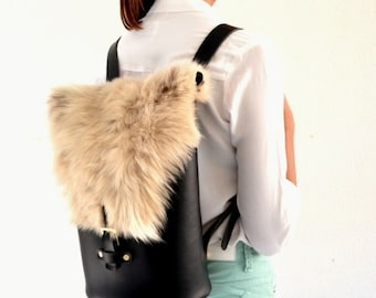 Leather black backpack with sheep fur