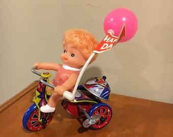 Girl on bike metal toy