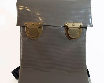 Backpack in Gray Shiny Color- Medium Size with Oversize Buckle. Rectangular Vertical Shape.
