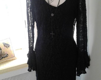 Black lace dress....vintage sheer, long sleeves....bell sleeves....sweet....Lew Magram