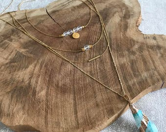 Accumulation of natural stone necklaces