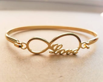 Bangle infinity love stainless steel gold plated.
