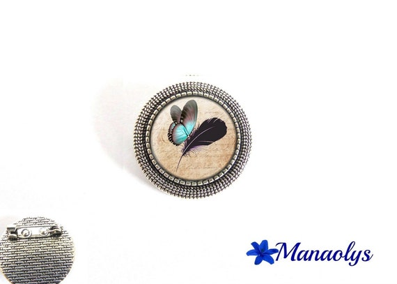 Brooch round antique silver, blue butterfly and feather, 21 glass cabochons