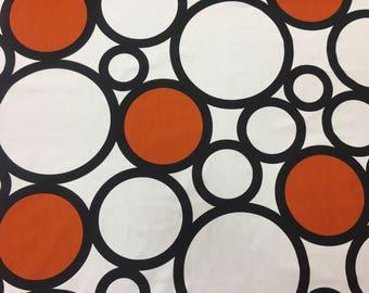 White fabric with black rings and orange circles, Scandinavian design