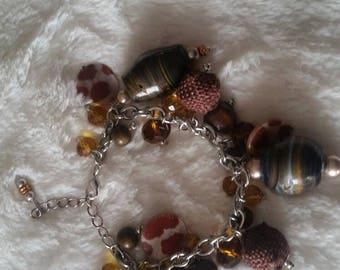 Charm bracelet brown/silvertone various beads