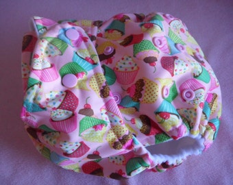 SassyCloth one size pocket diaper with cupcakes on pink PUL print. Made to order.
