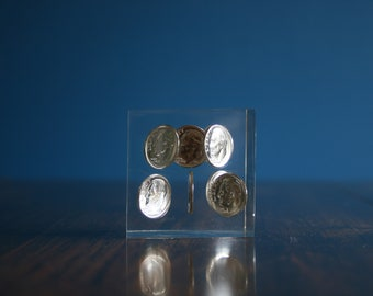 Paperweight: Lucite acrylic USA 10 cent dimes.