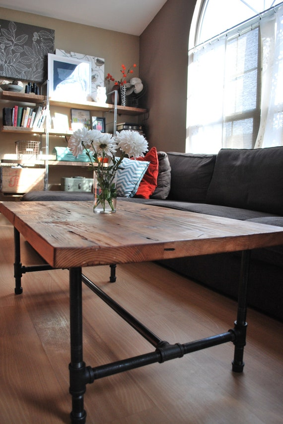 Wood Coffee Table With Steel Pipe Legs Made Of Reclaimed Wood.