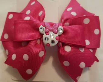 Pink and White polka dot Minnie Mouse bow.