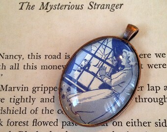 "Nancy Drew ""The Sign of the Twisted Candles"" pendant"