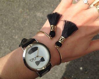 Gold Bangle adorned with 2 black tassels