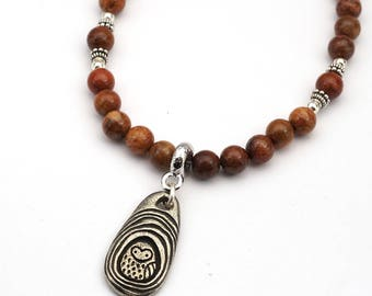 Nesting owl necklace with earthtones, rust red fossil coral beads, 18 1/2 inches long