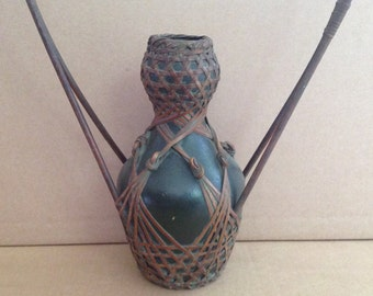 Tarra cotta Japanese vase with bamboe decorative structure