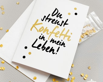 Typo gold konfetti 'Du streust Konfetti in mein Leben' Klapp-Karte by cute as a button