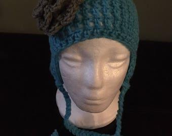 Light blue and grey crochet ear flap hat.
