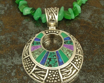 Sterling silver pendant inlaid with Australian opal, chrysoprase, spiderweb turquoise and sugilite by Mark Hileman.