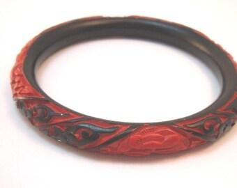 Faux cinnabar black and orange carved bangle bracelet