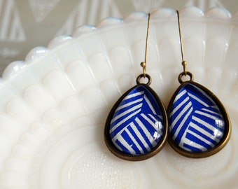abstract royal blue and white patterned teardrop earrings in aged brass settings