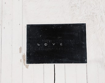 love black and white wooden sign