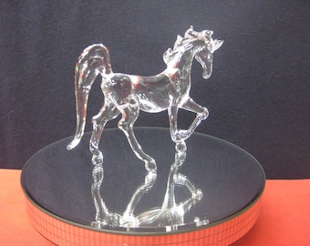 Small glass horse prancing