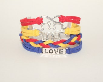 Autism Awareness Infinity cord bracelet, puzzle piece, love, faux suede cord, Red, yellow, and blue