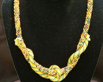 Hand crocheted,  glass beaded with rope embellishment.