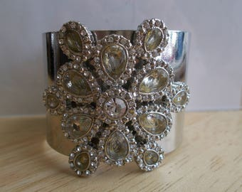 Silver Tone Cuff Bracelet with a Clear Rhinestone and Pail Green Crystal Medallion
