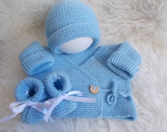 top hat and baby booties hand knitted blue wool
