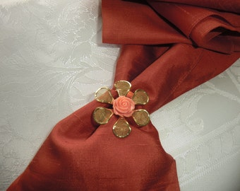 Scarf clip, metal gold flower with an orange centre, - pay for 3 different ones  - get  extra one free