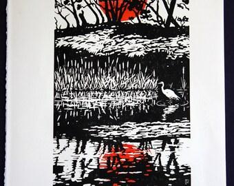 Handprinted linoleum block print: Morning has broken, sunrise, egret, black, red & white
