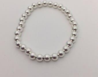 Simple stackable silver bead bracelet