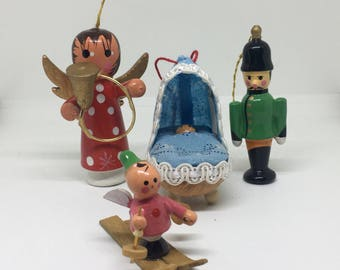 Four Wooden Christmas Ornaments, Angel, Toy Soldier, Skier, Baby in Bassinet