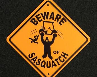 Beware of Sasquatch Golfcart 15 inch by 15 inch Metal Sign.  Bigfoot Golf Golfcart