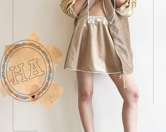 a gold-brown ha attitude skirt and a maching  bomber jaket, size2- 4,size34-36