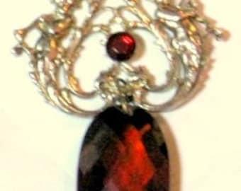 Garnet Necklace with Cherubs Blaring Trumpets