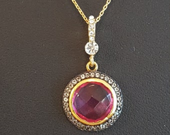 Pink Topaz pendant pave set with diamonds and 24K gold over silver and gold plated chain.