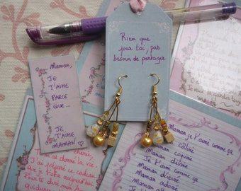 Gold and yellow pearl earrings