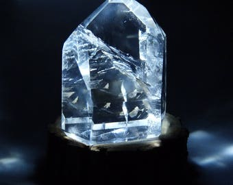 Light edge rock crystal, 65 mm x 60 mm height, weight 200 g stand raw oak with white light led Crystal